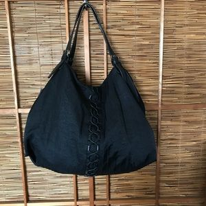Black nylon / leather laced adjustable tote bag